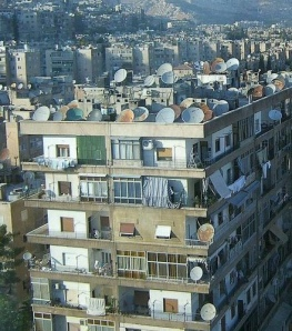 Although illegal to own, satellite dishes are pervasive inside Iran